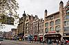 Damrak calle, Amsterdam, Países Bajos | Foto de stock