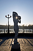 Sculpture of girl with pitcher in the backlight | Stock Foto