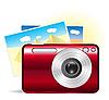 rote Kamera mit Reisen-Fotos
