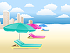 chairs with umbrellas on beach with clouds and