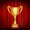 trophy golden cup on red curtain background