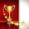 Golden sports cup on red curtain background with