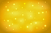 Vector clipart: Golden abstract background with glittering stars.