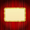 golden frame with light bulbs on red curtains