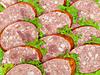 Sliced salami and lettuce   Stock Foto