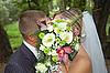 Groom and fiancee kiss | Stock Foto