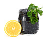 Caviar black in glass jar with lemon and parsley | Stock Foto