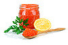Caviar red in glass jar with lemon and parsley | Stock Foto