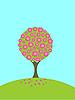 einem blühenden Baum auf dem grünen Rasen