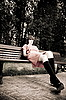 Pretty Woman Sitting On A Bench | Stock Foto