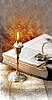 Candle with book   Stock Foto