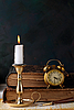 Candle with books and an alarm clock | Stock Foto