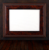 Wooden frame on the grunge wall   Stock Foto