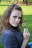 Beautiful girl holds dandelion in hand | Stock Foto