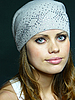 Blue-eyed girl in grey cap with pastes  | Stock Foto