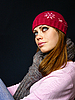 Girl in red cap and knitted scarf | Stock Foto