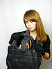 Young girl with black leather bag | Stock Foto