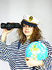 Photo 300 DPI: attractive woman seafarer with the globe