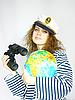 有吸引力的女子与全球的海员 | 免版税照片