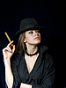 Photo 300 DPI: woman in cap and with cigarette