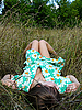 Beautiful young girl lies on grass | Stock Foto
