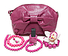 Purple feminine bag and necklace | Stock Foto