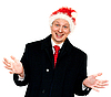 Man in suit with red tieand in Santa`s hat | Stock Foto