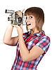Photo 300 DPI: Girl in plaid shirt with movie camera
