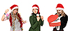 Three girls in christmas hat with gift   Stock Foto