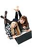 两个女孩是与计算机 | 免版税照片