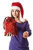 美丽的姑娘在红色圣诞老人的帽子 | 免版税照片