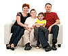 Family of four on sofa | Stock Foto