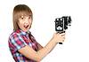 Beautiful girl in plaid shirt with movie camera | Stock Foto