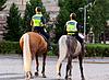 Photo 300 DPI: Two girls policeman on horses