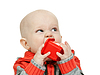 Little boy chewing on plastic pyramid | Stock Foto
