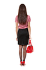 Chica delgada con mochila | Foto de stock