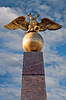 Photo 300 DPI: golden russian two-headed eagle sitting on an orb in