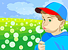 little boy blowing on dandelion in the meadow