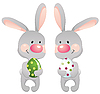 Funny rabbits with eggs | Stock Vector Graphics
