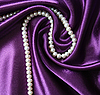 White pearls on lilac silk | Stock Foto