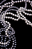 White and black pearls on the black silk | Stock Foto