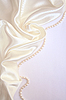 Smooth elegant white silk with pearls as wedding background  | Stock Foto