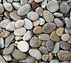 Grey pebbles as background | Stock Foto