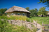 Old fence and Ukrainian rural house | Stock Foto