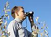 Boy with binoculars | Stock Foto