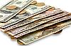 Dólares y monedas | Foto de stock
