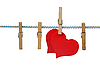 Red hearts on clothesline | Stock Foto