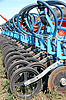 Tractor and seeder planting crops on field | Stock Foto