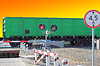 Railroad cars at crossing with barrier | 免版税照片