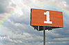 Фото 300 DPI: Оранжевый рекламный щит и радуга
